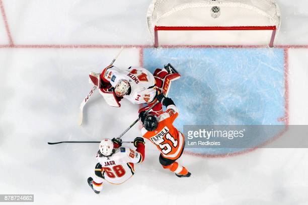 Jaromir Jagr and Mike Smith of the Calgary Flames defend their crease against Valtteri Filppula of the Philadelphia Flyers on November 18 2017 at the...