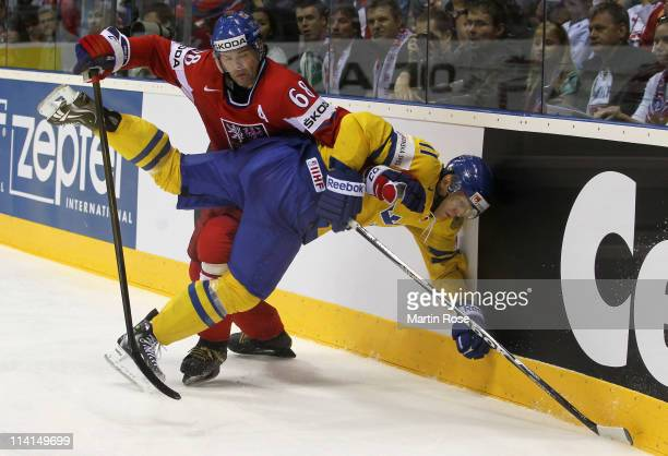 Jaromir Jagr of Czech Republic smashes Carl Gunnarsson of Sweden into the boards during the IIHF World Championship semi final match between Czech...