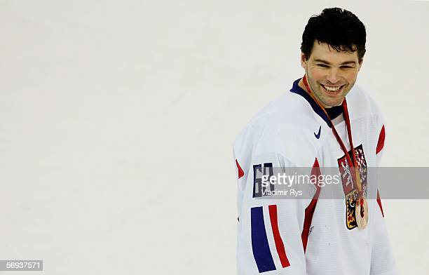 Jaromir Jagr of Czech Republic smiles after receving the bronze medal after their 3-1 win against Russia during Day 15 of the Turin 2006 Winter...