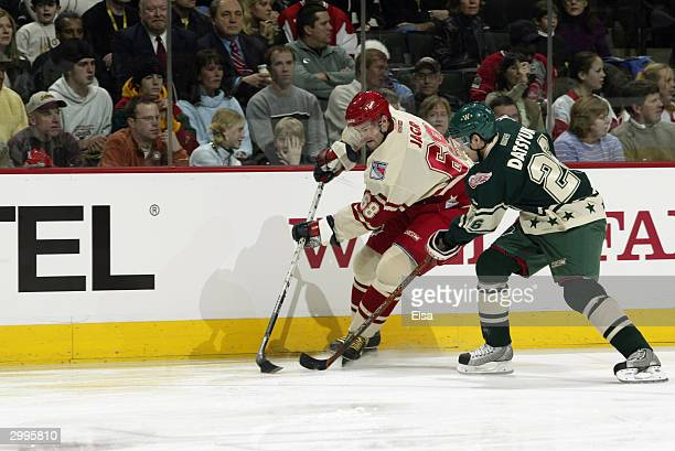 Jaromir Jagr of the AllStar East is defended by center Pavel Datsyuk of the AllStar West during the 54th NHL AllStar Game at the Xcel Energy Center...