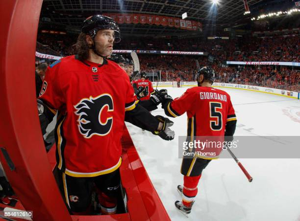 Jaromir Jagr of the Calgary Flames celebates with teammates after a goal against the Edmonton Oilers at Scotiabank Saddledome on December 2 2017 in...