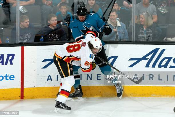 Jaromir Jagr of the Calgary Flames hits Brenden Dillon of the San Jose Sharks at SAP Center on December 28 2017 in San Jose California