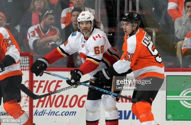 Jaromir Jagr of the Calgary Flames in action against Valtteri Filppula of the Philadelphia Flyers on November 18 2017 at the Wells Fargo Center in...