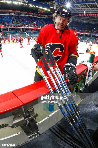 Jaromir Jagr of the Calgary Flames picks one of his sticks at warm up in a game against the Philadelphia Flyers at the Scotiabank Saddledome on...