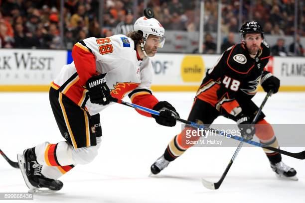 Jaromir Jagr of the Calgary Flames rushes toward the puck on a face off as Logan Shaw of the Anaheim Ducks looks on during the third period of a game...