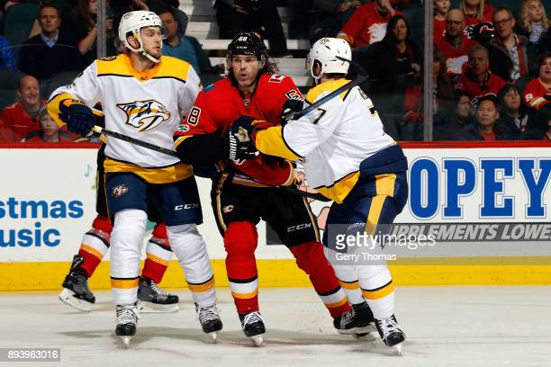 Jaromir Jagr of the Calgary Flames skates against Scott Harnell of the Nashville Predators during an NHL game on December 16 2017 at the Scotiabank...