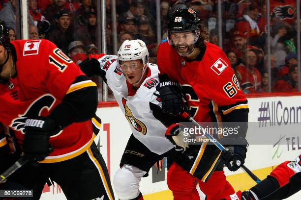 Jaromir Jagr of the Calgary Flames skates against Thomas Chabot of the Ottawa Senators during an NHL game on October 13 2017 at the Scotiabank...