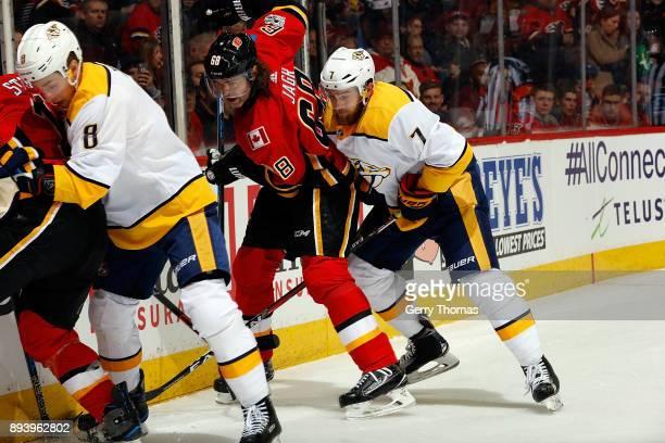 Jaromir Jagr of the Calgary Flames skates against Yannick Weber of the Nashville Predators during an NHL game on December 16 2017 at the Scotiabank...