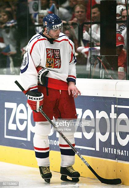 Jaromir Jagr of the Czech Republic looks at his injured finger while playing Germany in the IIHF World Men's Championships preliminary round group D...