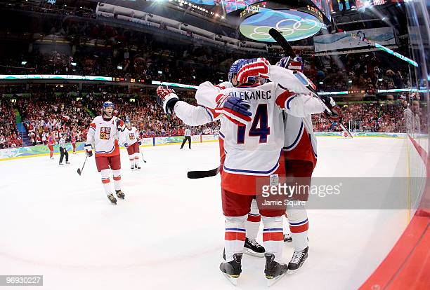 Jaromir Jagr of the Czech Republic skates toward his teammates as they celebrate with Tomas Plekanec after he scored a first period goal as goalie...