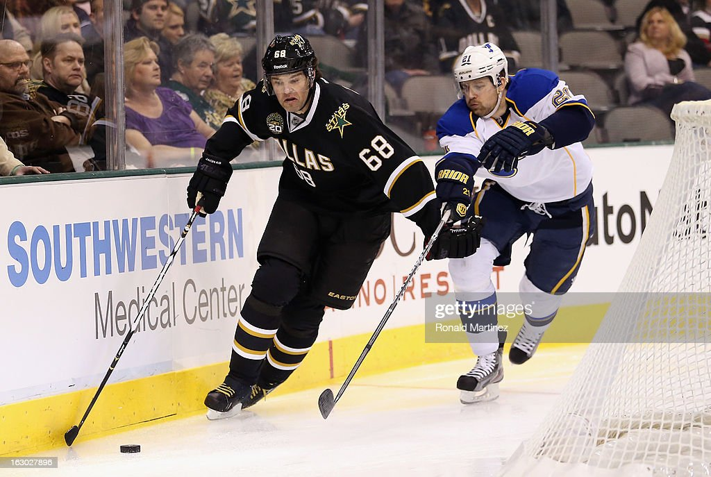 Jaromir Jagr #68 of the Dallas Stars skates the puck against Patrik Berglund #21 of the St. Louis Blues at American Airlines Center on March 3, 2013 in Dallas, Texas.