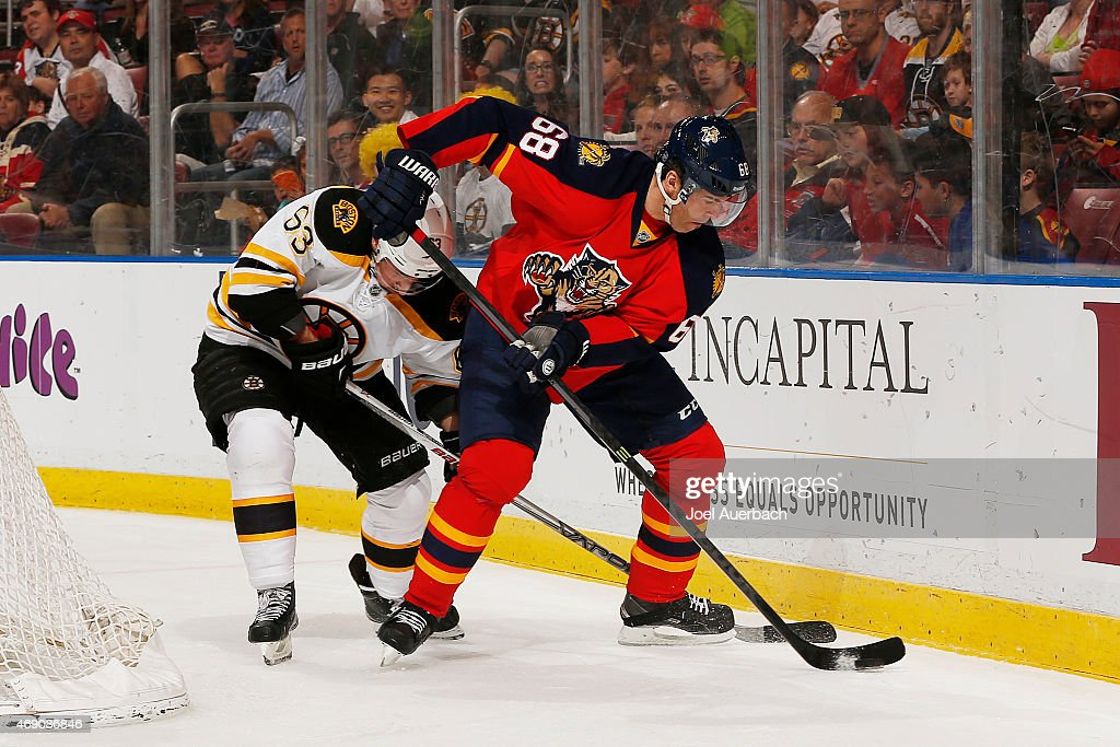 Jaromir Jagr #68 of the Florida Panthers and Brad Marchand #63 of the Boston Bruins battle for control of the puck during first period action at the BB&T Center on April 9, 2015 in Sunrise, Florida.