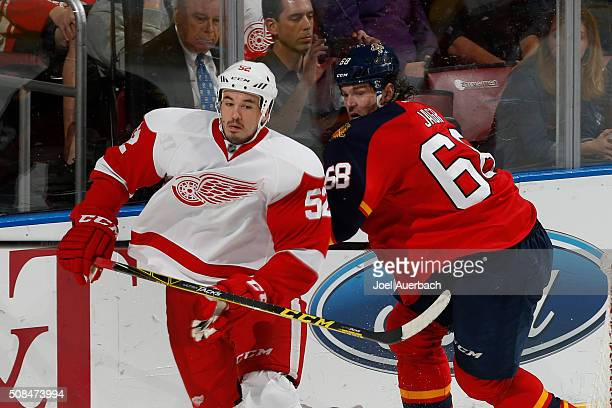 Jaromir Jagr of the Florida Panthers and Jonathan Ericsson of the Detroit Red Wings chase a loose puck during third period action at the BBT Center...