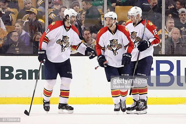 Jaromir Jagr of the Florida Panthers celebrates and Aleksander Barkov congratulate Jonathan Huberdeau after he scored against the Boston Bruins...