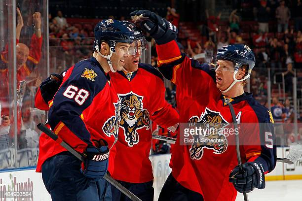 Jaromir Jagr of the Florida Panthers celebrates his goal with teammates Aaron Ekblad and Brian Campbell the Tampa Bay Lightning at the BBT Center on...