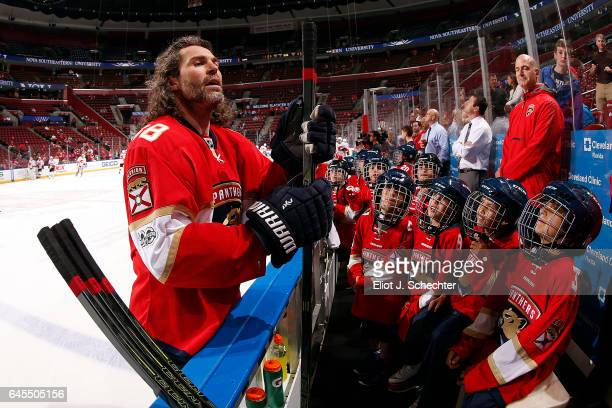 Jaromir Jagr of the Florida Panthers chats with kids sitting on the bench during warm ups prior to the start of the game against the Calgary Flames...