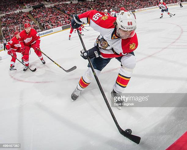 Jaromir Jagr of the Florida Panthers controls the puck in the corner during an NHL game against the Detroit Red Wings at Joe Louis Arena on November...