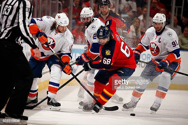 Jaromir Jagr of the Florida Panthers crosses sticks with Matt Martin of the New York Islanders in Game Five of the Eastern Conference First Round...