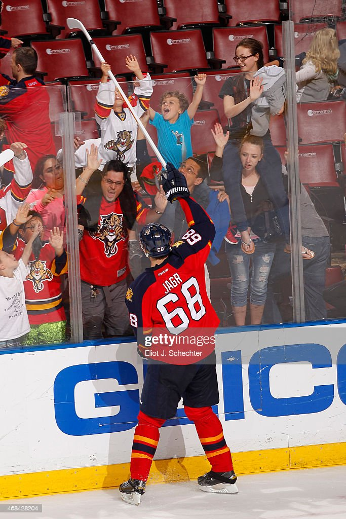 Jaromir Jagr #68 of the Florida Panthers gives a stick away to fans after their 6-1 win against the Carolina Hurricanes at the BB&T Center on April 2, 2015 in Sunrise, Florida.