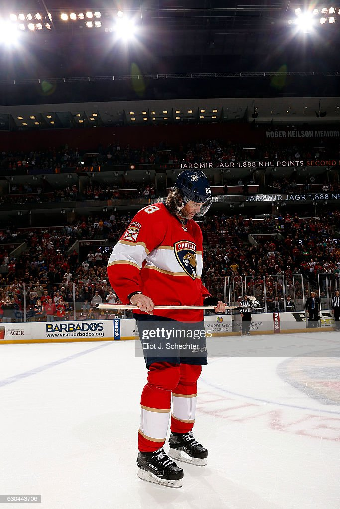 Jaromir Jagr #68 of the Florida Panthers holds a gold stick given to him by teammates. Jaromir Jagr is now in sole possession of second place on the all-time NHL scoring list with 1888 points at the BB&T Center on December 22, 2016 in Sunrise, Florida.