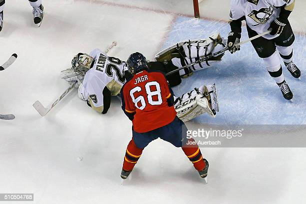 Jaromir Jagr of the Florida Panthers is unable to dig the puck out from under Goaltender MarcAndre Fleury of the Pittsburgh Penguins during overtime...