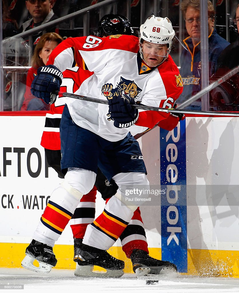 Jaromir Jagr #68 of the Florida Panthers knocks Adam Larsson #5 of the New Jersey Devils off the puck during the third period of an NHL hockey game at Prudential Center on December 6, 2015 in Newark, New Jersey. Devils won 4-2.