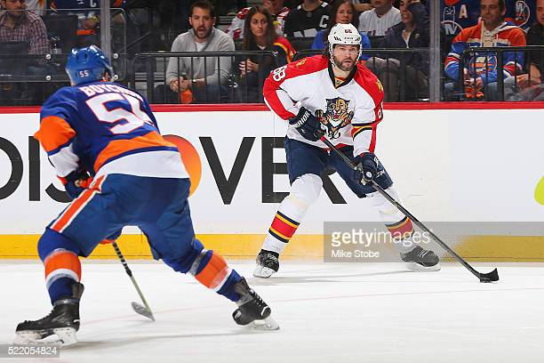 Jaromir Jagr of the Florida Panthers plays the puck against Johnny Boychuk of the New York Islanders in Game Three of the Eastern Conference...