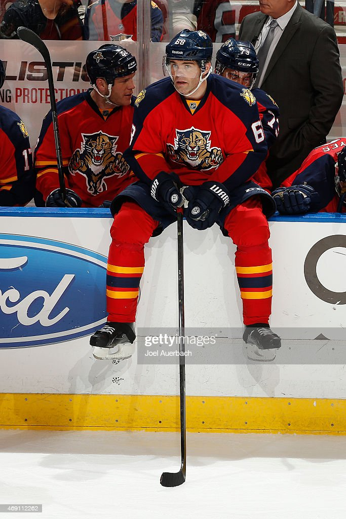 Jaromir Jagr #68 of the Florida Panthers sits on the boards after getting an assist on a goal against the Boston Bruins at the BB&T Center on April 9, 2015 in Sunrise, Florida. The assist was Jagr's 1,800th point in the NHL. The Panthers defeated the Bruins 4-2.