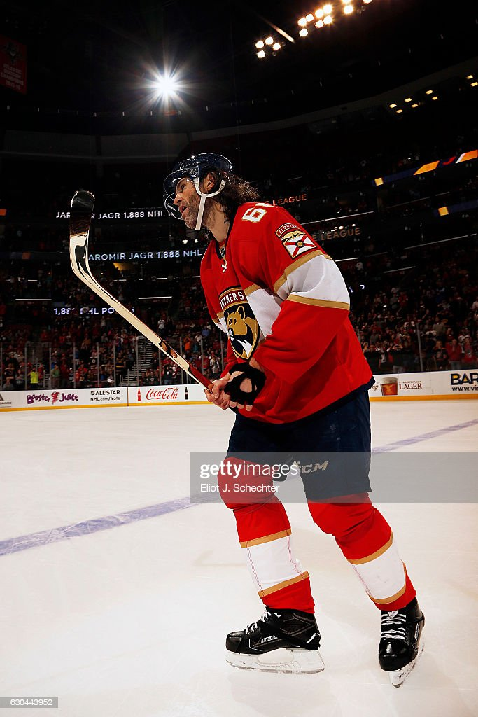 Jaromir Jagr #68 of the Florida Panthers skates the ice with a gold stick given to him by teammates. Jaromir Jagr is now in sole possession of second place on the all-time NHL scoring list with 1888 points at the BB&T Center on December 22, 2016 in Sunrise, Florida.