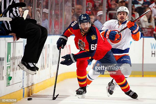 Jaromir Jagr of the Florida Panthers skates with the puck against Shane Prince of the New York Islanders in Game Five of the Eastern Conference First...