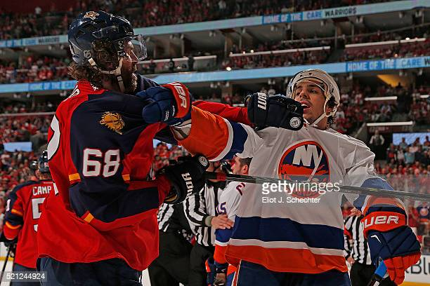 Jaromir Jagr of the Florida Panthers tangles with Travis Hamonic of the New York Islanders in Game One of the Eastern Conference Quarterfinals during...
