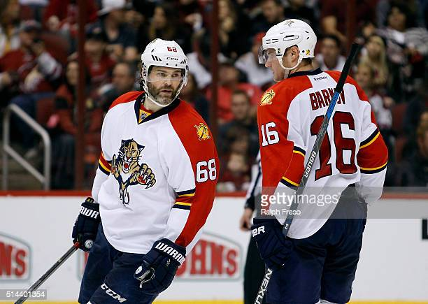Jaromir Jagr of the Florida Panthersl talks with teammate Aleksander Barkov during second period action against the Arizona Coyotes at Gila River...