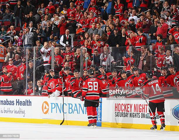 Jaromir Jagr of the New Jersey Devils is congratulated by his teammates after scoring his second goal in the firstperiod during the game against the...