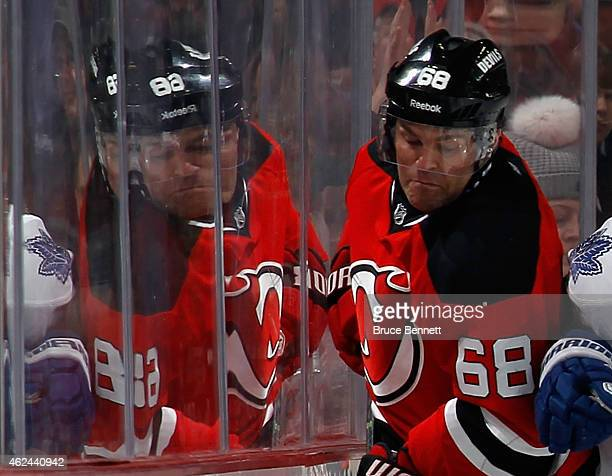Jaromir Jagr of the New Jersey Devils is hit into the glass during the third period against the Toronto Maple Leafs at the Prudential Center on...