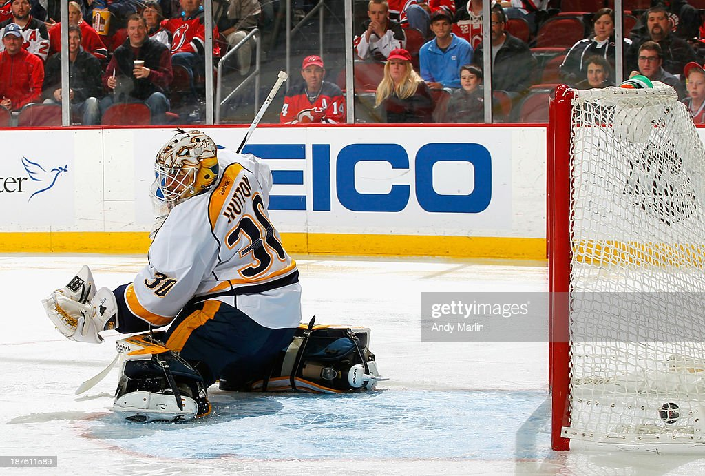 Jaromir Jagr #68 (not pictured) of the New Jersey Devils puts the puck past Carter Hutton #30 of the Nashville Predators for a first-period goal and his 1700th career NHL point during the game at the Prudential Center on November 10, 2013 in Newark, New Jersey.