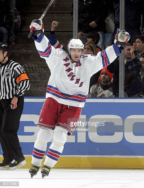 Jaromir Jagr of the New York Rangers celebrates his 110th point of the season after assisting on a goal by Petr Prucha during the first period of...