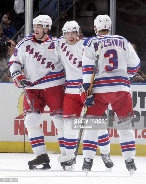 Jaromir Jagr of the New York Rangers celebrates with teammates Petr Prucha and Michal Rozsival after assisting on Prucha's goal against the New York...