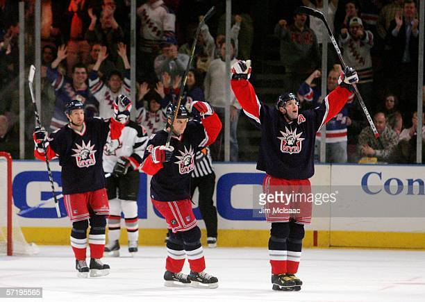 Jaromir Jagr of the New York Rangers celebrates with teammates Sandis Ozolinsh and Michael Nylander after Jagr scored his 52nd goal of the season...