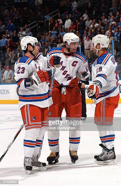 Jaromir Jagr of the New York Rangers huddles with Chris Drury and Scott Gomez during a break in the game against the Atlanta Thrashers at Philips...