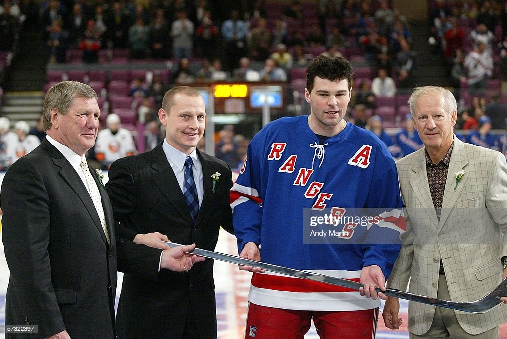 Jaromir Jagr #68 of the New York Rangers is awarded a silver stick by Vic Hatfield (L) Adam Graves and Jean Ratelle (R) prior to the game against the New York Islanders on April 11, 2006 at Madison Square Garden in New York City.