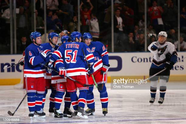 Jaromir Jagr of the New York Rangers is congratulated by his teammates on his goal in the first period against the Washington Capitals during the...