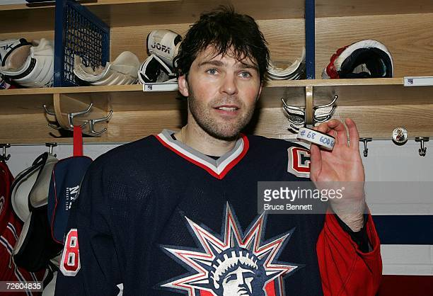 Jaromir Jagr of the New York Rangers poses with the puck that he scored his 600th NHL goal with after their game against the Tampa Bay Lightning on...