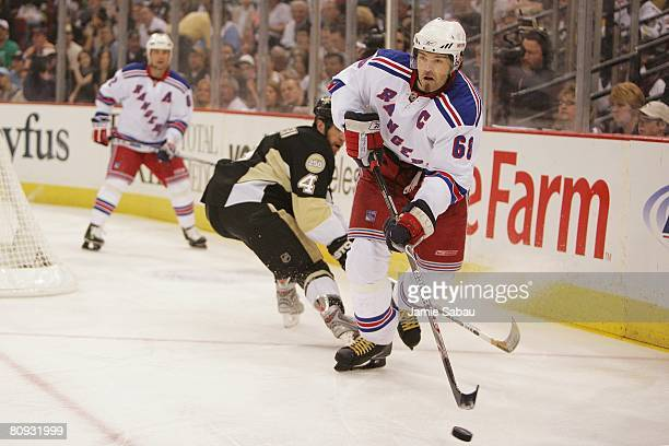 Jaromir Jagr of the New York Rangers skates with the puck against the Pittsburgh Penguins during game two of the Eastern Conference Semifinals of the...