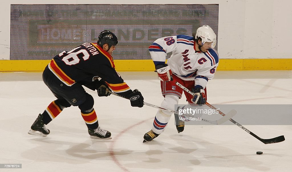 Jaromir Jagr #68 of the New York Rangers skates with the puck as Nathan Horton #16 of the Florida Panthers defends during the NHL game on December 21, 2006 at the BankAtlantic Center in Sunrise, Florida. The Panthers defeated the Rangers 3-2.