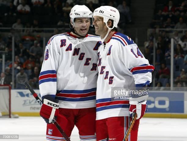 Jaromir Jagr of the New York Rangers talks with teammate Brendan Shanahan during a break in their NHL preseason game against the New York Islanders...