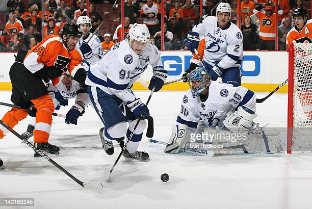 Jaromir Jagr of the Philadelphia Flyers battles for the puck in the crease against Tom Pyatt Steven Stamkos Dwayne Roloson and Eric Brewer of the...