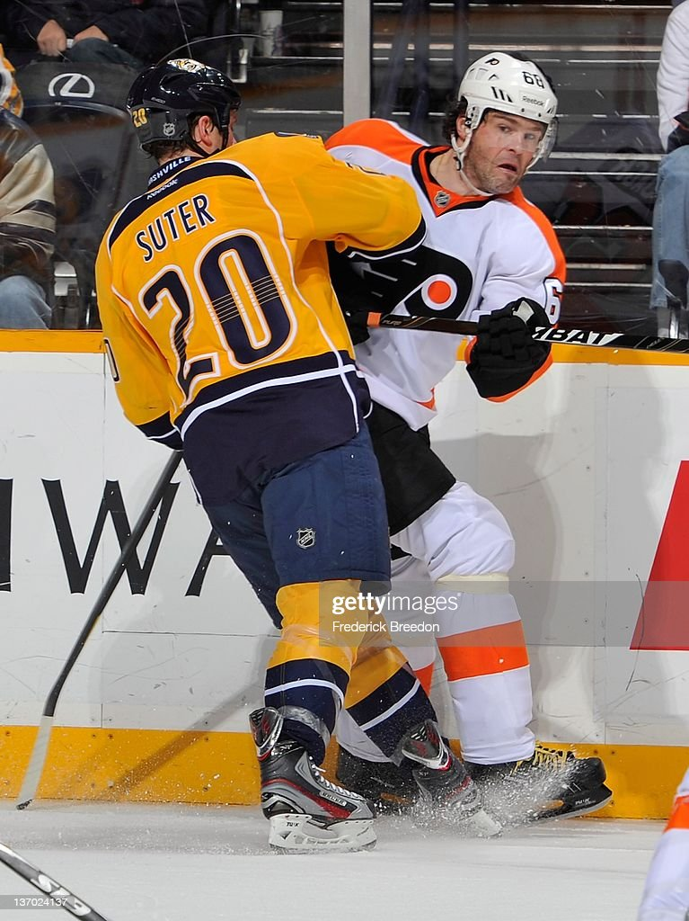 Jaromir Jagr #68 of the Philadelphia Flyers is checked by Ryan Suter #20 of the Nashville Predators at Bridgestone Arena on January 14, 2012 in Nashville, Tennessee.