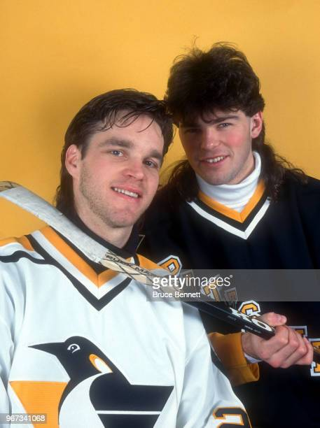 Jaromir Jagr of the Pittsburgh Penguins pretends to hook his teammate Luc Robitaille as they pose for a portrait circa February 1995