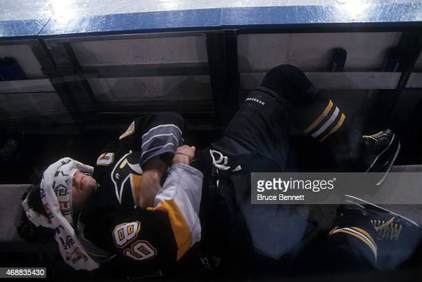 Jaromir Jagr of the Pittsburgh Penguins rests on the bench before an NHL game against the New York Rangers on March 21 1999 at the Madison Square...