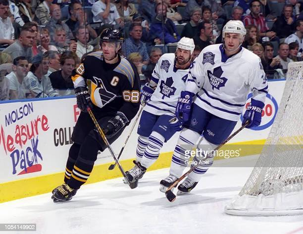 Jaromir Jagr of the Pittsburgh Penguins skates against Dmitri Yushkevich and Kris King of the Toronto Maple Leafs during the 1999 Quarter Finals of...